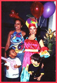 Kids enjoy a Carmen Miranda singing telegram in NYC as much as their mother does for this birthday singing telegram.  Delilah makes balloon animals for the kids as well as a balloon crown for the singing telegram entertainment.
