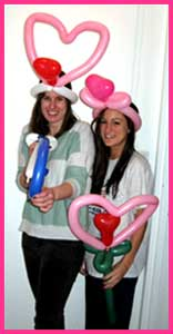 Roommates get to share the fun of a singing telegram with customized balloon hats.  Birthday singing telegrams are a great way to say happy birthday!