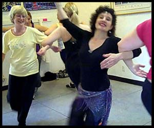 Square dancing in Delilah's World Beat Workout dance exercise class